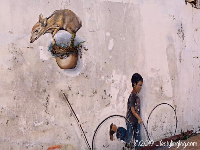 動物と子供のストリートアート